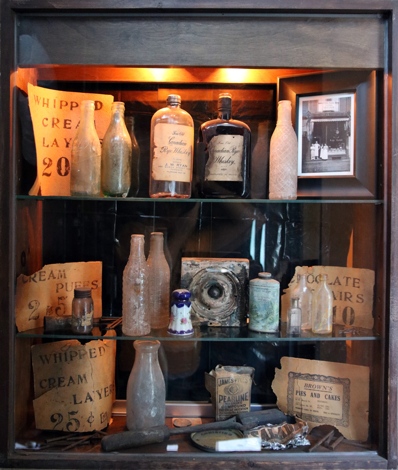 Display case showing artifacts from the building's previous shops and owners, found during renovations