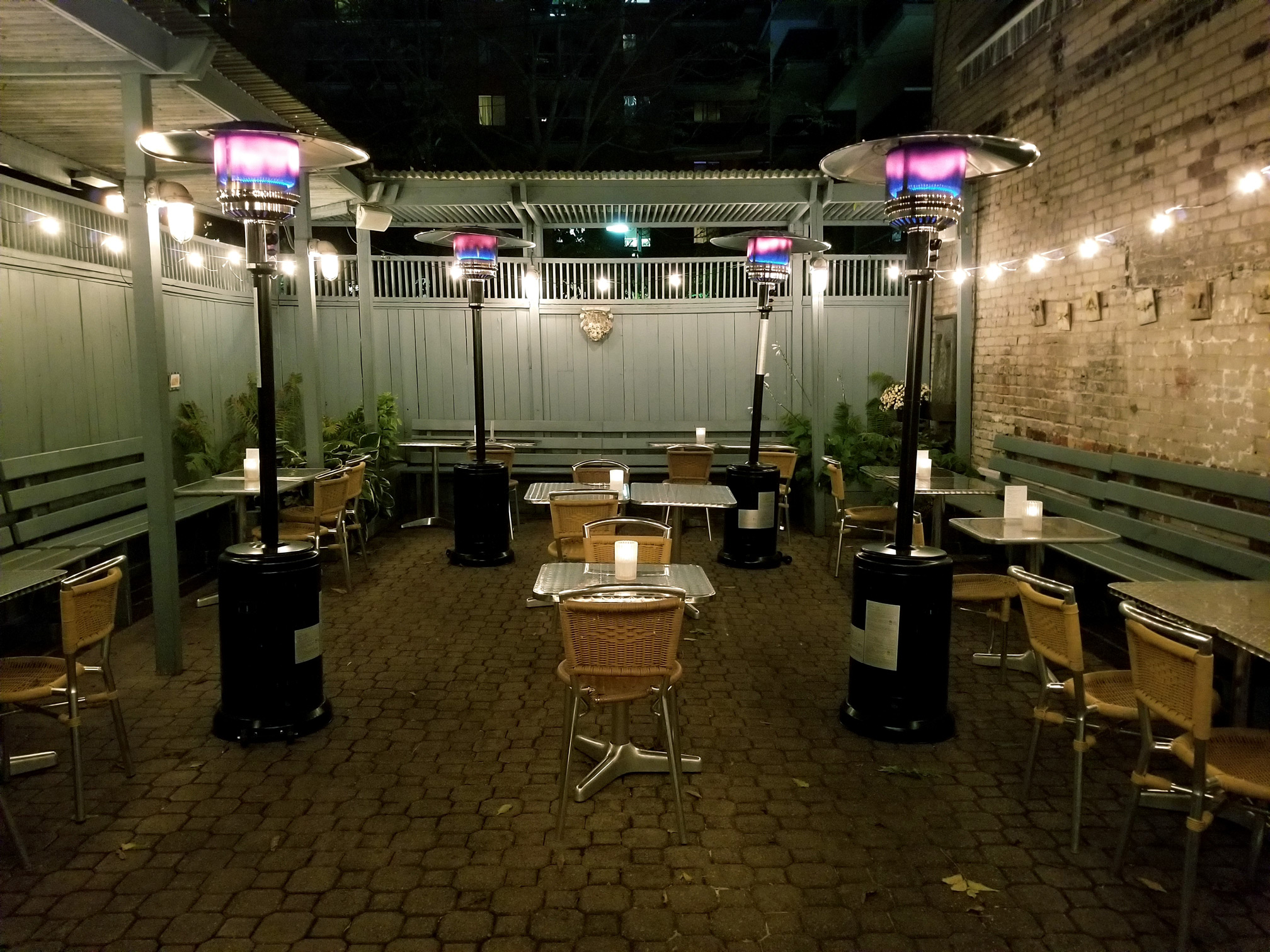 Patio at night with heaters